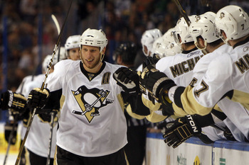 TAMPA, FL - APRIL 25: Jordan Staal #11 of the Pittsburgh Penguins celebrates a goal with teammates against the Tampa Bay Lightning in Game Six of the Eastern Conference Quarterfinals during the 2011 NHL Stanley Cup Playoffs at the St. Pete Times Forum on