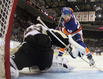 UNIONDALE, NY - APRIL 08: Michael Grabner #40 of the New York Islanders shoots on Marc-Andre Fleury #29 of the Pittsburgh Penguins at the Nassau Coliseum on April 8, 2011 in Uniondale, New York.  (Photo by Bruce Bennett/Getty Images)