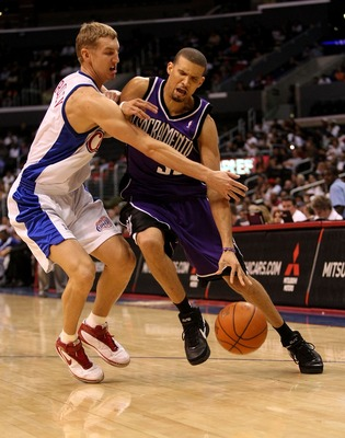 LOS ANGELES - OCTOBER 24: Francsico Garcia #32 of the Sacramento Kings draws a foul from Yaroslav Korolev #8 of the Los Angeles Clippers on October 24, 2007 at Stpales Center in Los Angeles, California.  (Photo by Stephen Dunn/Getty Images)