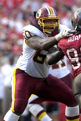 TAMPA, FL - NOVEMBER 25: Tackle Chris Samuels #60 of the Washington Redskins blocks against the Tampa Bay Buccaneers at the Raymond James Stadium on November 25, 2007 in Tampa, Florida.  The Bucs won 19-13. (Photo by Al Messerschmidt/Getty Images)
