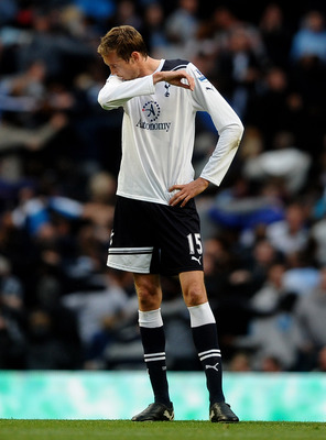 MANCHESTER, ENGLAND - MAY 10:  Peter Crouch  of Tottenham Hotspur looks dejected after scoring an own goal during the Barclays Premier League match between Manchester City and Tottenham Hotspur at the City of Manchester Stadium on May 10, 2011 in Manchest