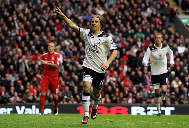 LIVERPOOL, ENGLAND - MAY 15:  Luka Modric of Spurs celebrates after scoring his team's second goal from the penalty spot during the Barclays Premier League match between Liverpool and Tottenham Hotspur at Anfield on May 15, 2011 in Liverpool, England.  (P