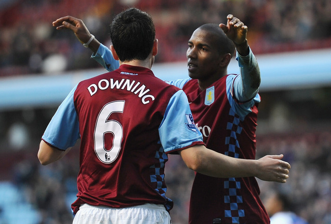 BIRMINGHAM, ENGLAND - FEBRUARY 26: Ashley Young of Aston Villa celebrates his second goal with Stewart Downing  during the Barclays Premier League match between Aston Villa and Blackburn Rovers at Villa Park on February 26, 2011 in Birmingham, England.  (