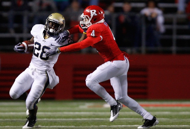 PISCATAWAY, NJ - OCTOBER 16: Dion Lewis #28 of the University of Pittsburgh Panthers stiff arms David Rowe #4 of the Rutgers University Scarlett Knights on October 16, 2009 at Rutgers Stadium in Piscataway, New Jersey. (Photo by Jared Wickerham/Getty Imag