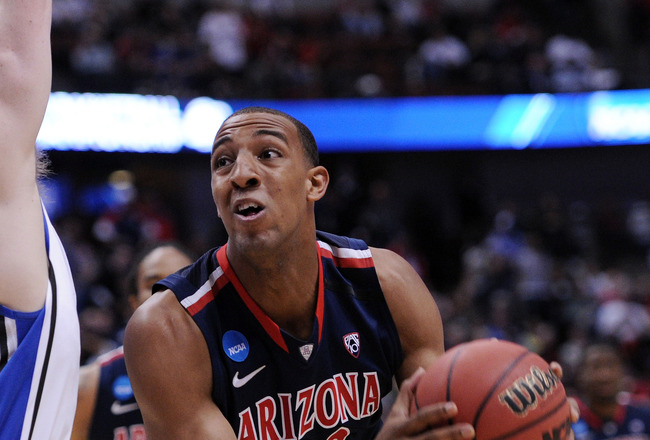 ANAHEIM, CA - MARCH 24:  Derrick Williams #23 of the Arizona Wildcats handles the ball against Kyle Singler #12 of the Duke Blue Devils  during the west regional semifinal of the 2011 NCAA men's basketball tournament at the Honda Center on March 24, 2011