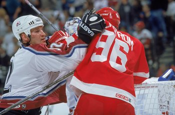 29 Apr 2000: Tomas Holmstrom #96 of the Detroit Red Wings duke it out with Adam Foote #52 of the Colorado Avalanche during the Round Two Playoff Game at the Pepsi Center in Denver, Colorado. The Avalanche defeated the Red Wings 3-1.