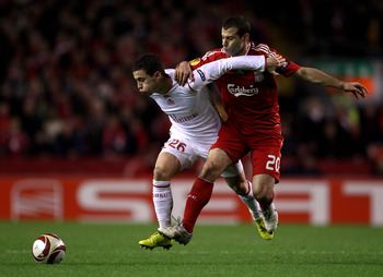 LIVERPOOL, ENGLAND - MARCH 18:  Javier Mascherano of Liverpool battles for the ball with Eden Hazard of Lille during the UEFA Europa League Round of 16, second leg match at Anfield on March 18, 2010 in Liverpool, England.  (Photo by Alex Livesey/Getty Ima