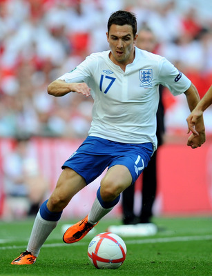 LONDON, ENGLAND - JUNE 04:  Stewart Downing of England competes with Reto Ziegler of Switzerland during the UEFA EURO 2012 group G qualifying match between England and Switzerland at Wembley Stadium on June 4, 2011 in London, England.  (Photo by Clive Mas