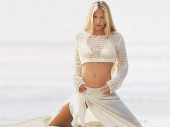 1258097028_1024x768_anna-kournikova-in-white_display_image