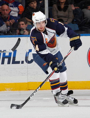 UNIONDALE, NY - MARCH 24:  Tim Stapleton #14 of the Atlanta Thrashers skates during an NHL hockey game against the New York Islanders at the Nassau Coliseum on March 24, 2011 in Uniondale, New York.  (Photo by Paul Bereswill/Getty Images)