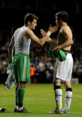 LONDON, ENGLAND - APRIL 13:  Iker Casillas of Real Madrid shakes hands with Gareth Bale of Spurs after the UEFA Champions League quarter final second leg match between Tottenham Hotspur and Real Madrid at White Hart Lane on April 13, 2011 in London, Engla