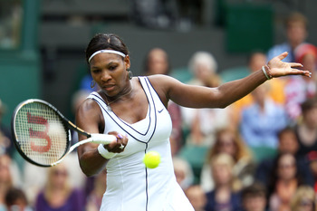 LONDON, ENGLAND - JUNE 21:  Serena Williams of the United States returns a shot during her first round match against Aravane Rezai of France on Day Two of the Wimbledon Lawn Tennis Championships at the All England Lawn Tennis and Croquet Club on June 21,
