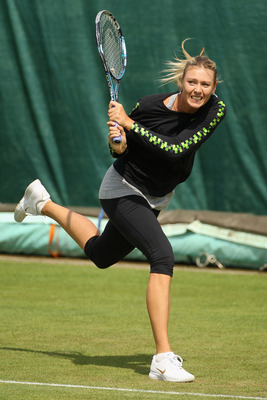 WIMBLEDON, ENGLAND - JUNE 18: Maria Sharapova of Russia trains on the Aorangi Practice court at the All England Lawn Tennis and Croquet Club ahead of the Wimbledon Lawn Tennis Championships on June 18, 2011 in London, England. The Championships, which are