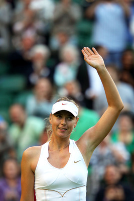 LONDON, ENGLAND - JUNE 21:  Maria Sharapova of Russia waves to the audience after winning her first round match against Anna Chakvetadze of Russia on Day Two of the Wimbledon Lawn Tennis Championships at the All England Lawn Tennis and Croquet Club on Jun