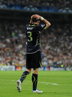 MADRID, SPAIN - APRIL 05:  Gareth Bale of Tottenham Hotspur trudgess off after failing to score during the UEFA Champions League quarter final first leg match between Real Madrid and Tottenham Hotspur at Estadio Santiago Bernabeu on April 5, 2011 in Madri