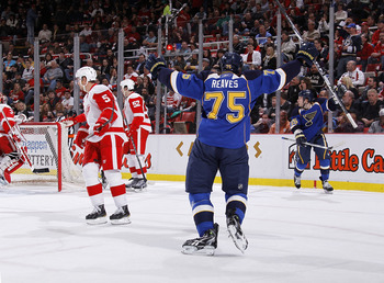 DETROIT, MI - MARCH 30: Ryan Reaves #75 of the St. Louis Blues celebrates a first-period goal by teammate Cam Janssen #55 in front of Nicklas Lidstrom #5 of the Detroit Red Wings at Joe Louis Arena on March 30, 2011 in Detroit, Michigan.  (Photo by Gregor