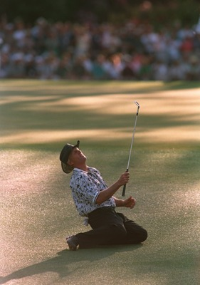 14 Apr 1996 :  Greg Norman of Australia collapses on the ground after narrowly missing his chip shot on the 15th green during the final tound of the 1996 US Masters Golf Championship at the Augusta National Golf Club in Augusta, Georgia. Nick Faldo wenton