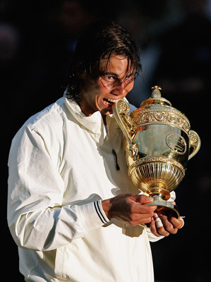 LONDON - JULY 06:  Rafael Nadal of Spain celebrates with the Championship trophy after winning the men's singles Final match against Roger Federer of Switzerland on day thirteen of the Wimbledon Lawn Tennis Championships at the All England Lawn Tennis and