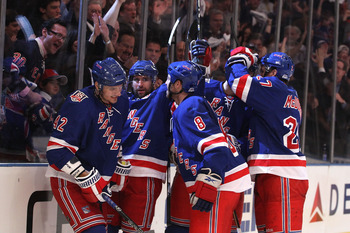 NEW YORK, NY - APRIL 20:  Artem Anisimov #42 (L) of the New York Rangers celebrates with his teammates after he scored a seocnd period goal against the Washington Capitals in Game Four of the Eastern Conference Quarterfinals during the 2011 NHL Stanley Cu