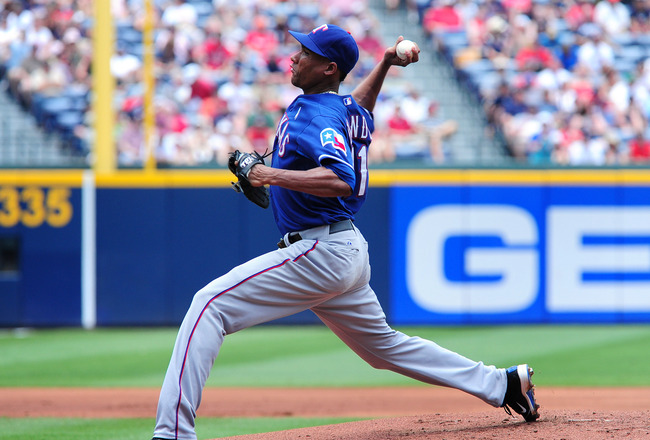 ATLANTA - JUNE 19: Alexi Ogando #41 of the Texas Rangers pitches against the Atlanta Braves at Turner Field on June 19, 2011 in Atlanta, Georgia. (Photo by Scott Cunningham/Getty Images)