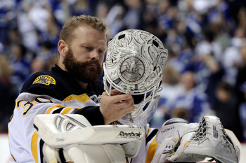 VANCOUVER, BC - JUNE 15: Tim Thomas #30 of the Boston Bruins puts on his helmet prior to the start of Game Seven against the Vancouver Canucks in the 2011 NHL Stanley Cup Final at Rogers Arena on June 15, 2011 in Vancouver, British Columbia, Canada.  (Pho