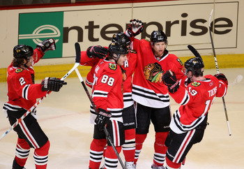 CHICAGO, IL - APRIL 17: (L-R) Duncan Keith #2, Patrick Kane #88, Patrick Sharp #10, Brian Campbell #51 and Jonathan Toews #19 of the Chicago Blackhawks celebrate a 2nd period goal against the Vancouver Canucks in Game Three of the Western Conference Quart