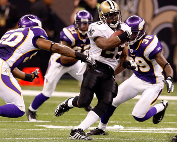 NEW ORLEANS - OCTOBER 06:  Reggie Bush #25 of the New Orleans Saints gets past Erin Henderson #50 of the Minnesota Vikings on October 6, 2008 at the Superdome in New Orleans, Louisiana.  Bush tied an NFL record by returning two punts for touchdowns in a g