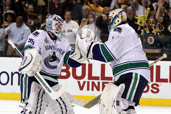BOSTON, MA - JUNE 13:  Cory Schneider #35 of the Vancouver Canucks greets Roberto Luongo #1 after replacing him in the first period during Game Six of the 2011 NHL Stanley Cup Final at TD Garden on June 13, 2011 in Boston, Massachusetts.  (Photo by Elsa/G