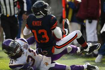 CHICAGO - NOVEMBER 14: Johnny Knox #13 of the Chicago Bears is tackled by Chris Cook #31 of the Minnesota Vikings at Soldier Field on November 14, 2010 in Chicago, Illinois. The Bears defeated the Vikings 27-13. (Photo by Jonathan Daniel/Getty Images)