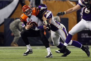 MINNEAPOLIS, MN - DECEMBER 13:  Carson Palmer #9 of the Cincinnati Bengals is sacked by Brian Robison #96 of the Minnesota Vikings on December 13, 2009 at Hubert H. Humphrey Metrodome in Minneapolis, Minnesota. (Photo by Jim McIsaac/Getty Images)
