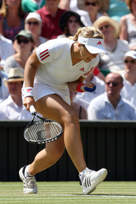 WIMBLEDON, ENGLAND - JUNE 30:  Sabine Lisicki of Germany celebrates during the women's singles quarter final match against Dinara Safina of Russia on Day Eight of the Wimbledon Lawn Tennis Championships at the All England Lawn Tennis and Croquet Club on J