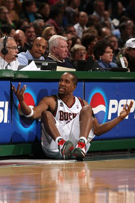 MILWAUKEE - JANUARY 22:  Michael Redd #22 of the Milwaukee Bucks gestures as he sits next to the scorer's table against the Phoenix Suns at the Bradley Center on January 22, 2008 in Milwaukee, Wisconsin. The Suns won 114-105. NOTE TO USER: User expressly