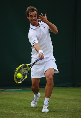 LONDON, ENGLAND - JUNE 22:  Richard Gasquet of France returns a shot during his second round match against Igor Kunitsyn of Russia on Day Three of the Wimbledon Lawn Tennis Championships at the All England Lawn Tennis and Croquet Club on June 22, 2011 in