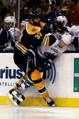 BOSTON, MA - JUNE 13:  Zdeno Chara #33 of the Boston Bruins checks Alexander Edler #23 of the Vancouver Canucks during Game Six of the 2011 NHL Stanley Cup Final at TD Garden on June 13, 2011 in Boston, Massachusetts.  (Photo by Elsa/Getty Images)