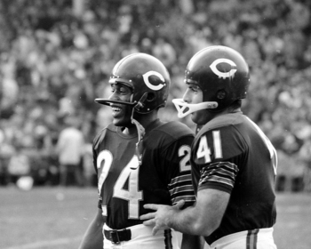 Rosey Taylor and Brian Piccolo share some laughs before a game.
