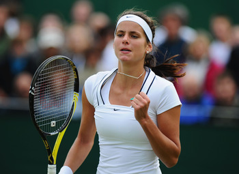 LONDON, ENGLAND - JUNE 22:  Julia Goerges of Germany reacts to a play during her first round match against Anabel Medina Garrigues of Spain on Day Three of the Wimbledon Lawn Tennis Championships at the All England Lawn Tennis and Croquet Club on June 22,