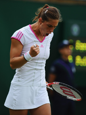 LONDON, ENGLAND - JUNE 21:  Andrea Petkovic of Germany reacts during her first round match against Stephanie Foretz Gacon of France on Day Two of the Wimbledon Lawn Tennis Championships at the All England Lawn Tennis and Croquet Club on June 21, 2011 in L