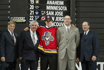 NASHVILLE, TN - JUNE 21:  Ron Harris, Darwin Bennett, Nathan Horton, Scott Luce and Mike Keenan of the Florida Panthers pose for a portrait on stage during the 2003 NHL Entry Draft at the Gaylord Entertainment Center on June 21, 2003 in Nashville, Tenness