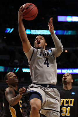 CHICAGO, IL - MARCH 18:  Chris Wright #4 of the Georgetown Hoyas shoots against Darius Theus #10 and Toby Veal #31 of the Virginia Commonwealth Rams in the first half during the second round of the 2011 NCAA men's basketball tournament at the United Cente