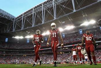 GLENDALE, AZ - DECEMBER 25:  (L-R) Steve Breaston #15, Larry Fitzgerald #11 and Darnell Dockett #90 of the Arizona Cardinals walk off the field following warm ups to the NFL game against the Dallas Cowboys at the University of Phoenix Stadium on December