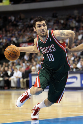 DALLAS - JANUARY 26:  Forward Carlos Delfino #10 of the Milwaukee Bucks drives to the basket during a game against the Dallas Mavericks on January 26, 2010 at American Airlines Center in Dallas, Texas.  NOTE TO USER: User expressly acknowledges and agrees