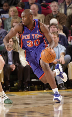 SEATTLE - DECEMBER 3:  Frank Williams #30 of the New York Knicks moves the ball during the game against the Seattle SuperSonics on December 3, 2003 at Key Arena in Seattle, Washington.  The Sonics won 95-87.  NOTE TO USER: User expressly acknowledges and