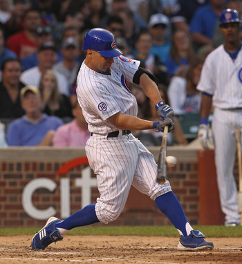 CHICAGO, IL - JUNE 19: Reed Johnson #5 of the Chicago Cubs hits the ball against the New York Yankees at Wrigley Field on June 19, 2011 in Chicago, Illinois. The Yankees defeated Cubs 10-4.(Photo by Jonathan Daniel/Getty Images)