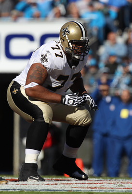 CHARLOTTE, NC - NOVEMBER 07:  Carl Nicks #77 of the New Orleans Saints against the Carolina Panthers during their game at Bank of America Stadium on November 7, 2010 in Charlotte, North Carolina.  (Photo by Streeter Lecka/Getty Images)