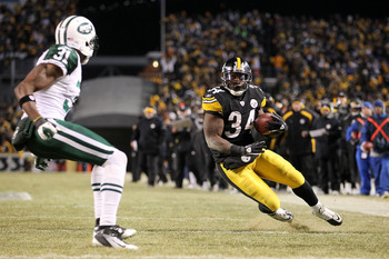 PITTSBURGH, PA - JANUARY 23:  Rashard Mendenhall #34 of the Pittsburgh Steelers runs down field against Antonio Cromartie #31 of the New York Jets during the 2011 AFC Championship game at Heinz Field on January 23, 2011 in Pittsburgh, Pennsylvania. The St