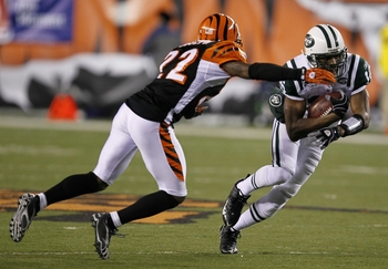 CINCINNATI - JANUARY 9:  Brad Smith #16 of the New York Jets runs the ball against Johnathan Joseph #22 of the Cincinnati Bengals during the 2010 AFC wild-card playoff game at Paul Brown Stadium on January 9, 2010 in Cincinnati, Ohio. (Photo by Jonathan D