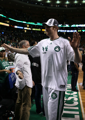 BOSTON - MAY 28:  Brian Scalabrine of the Boston Celtics celebrates after the Celtics won 96-84 against the Orlando Magic in Game Six of the Eastern Conference Finals during the 2010 NBA Playoffs at TD Garden on May 28, 2010 in Boston, Massachusetts.  NOT