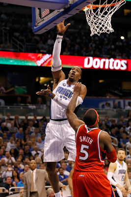 ORLANDO, FL - APRIL 16:  Dwight Howard #12 of the Orlando Magic shoots over Josh Smith #5 of the Atlanta Hawks during Game One of the Eastern Conference Quarterfinals of the 2011 NBA Playoffs on April 16, 2011 at the Amway Arena in Orlando, Florida.  NOTE