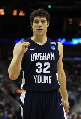 NEW ORLEANS, LA - MARCH 24:  Jimmer Fredette #32 of the Brigham Young Cougars celebrates against the Florida Gators during the Southeast regional of the 2011 NCAA men's basketball tournament at New Orleans Arena on March 24, 2011 in New Orleans, Louisiana
