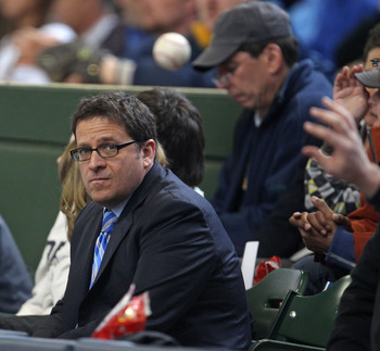 MILWAUKEE, WI - APRIL 04: Owner Mark Attanasio of the Milwaukee Brewers watches as a fan catches a foul ball during the home opener against the Atlanta Braves at Miller Park on April 4, 2011 in Milwaukee, Wisconsin. (Photo by Jonathan Daniel/Getty Images)